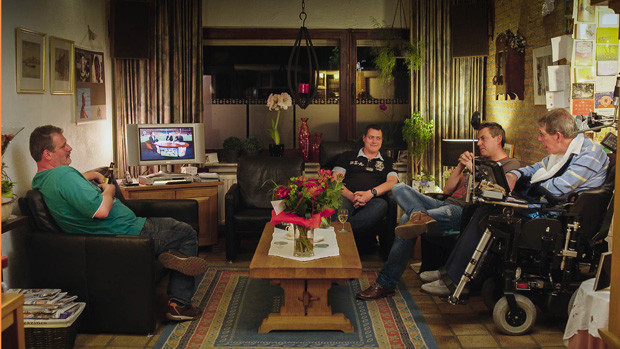 Wim and his sons in the living room