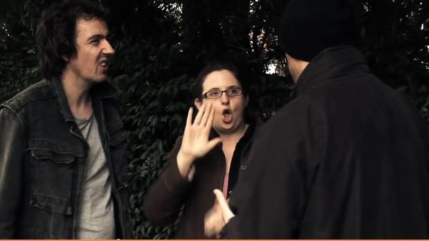 A sign language interpreter between a deaf mugger and his victim