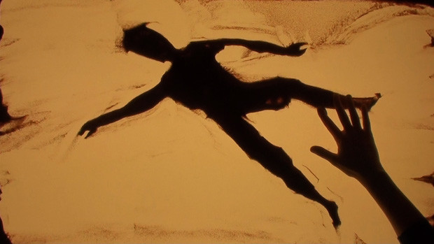 Sand painting of a human body