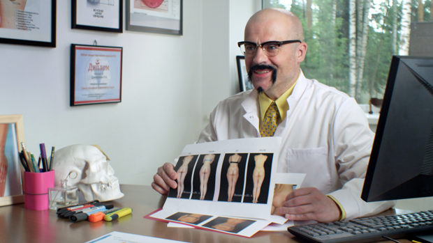 A plastic surgeon presenting a catalogue of womens' buttocks
