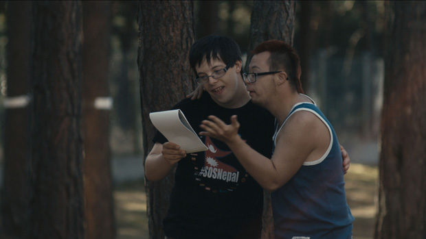 Two yopun men with Down-Syndrome reciting a poem in a park
