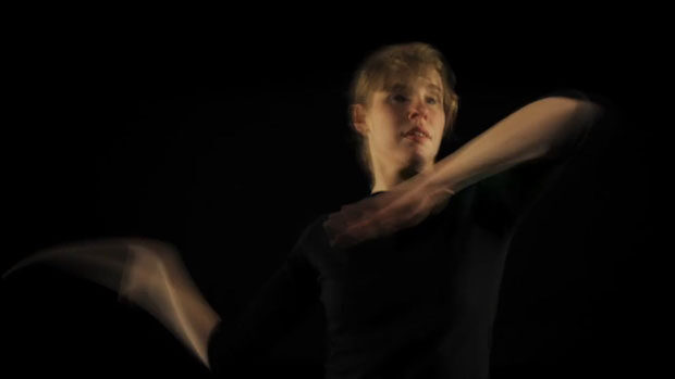 A young woman dancing in the dark