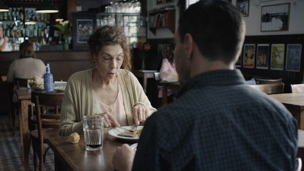 An elderly lady and her son having lunch in a restaurant