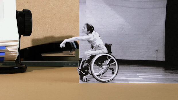 Animated filmstill of a woman performing mdern dance in a wheelchair